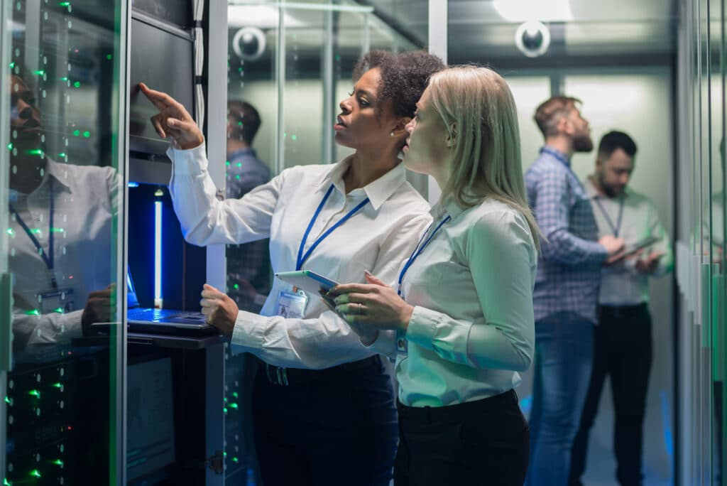 IT experts in a server room