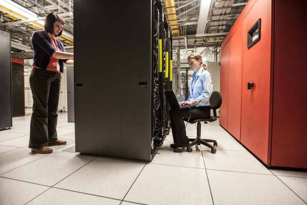2 women working in server room