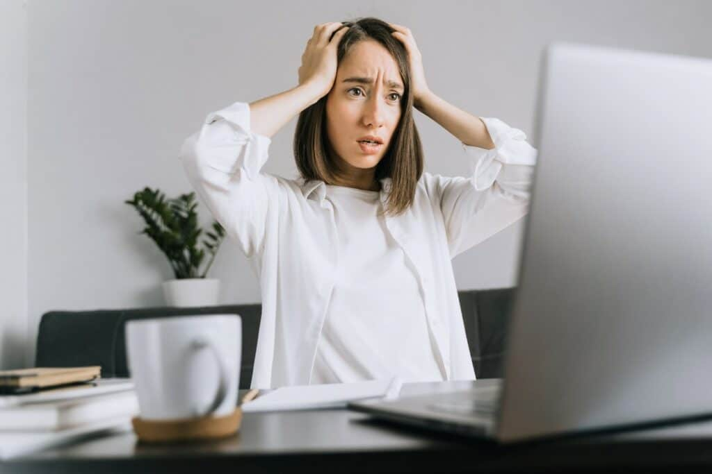Woman stressed about a cyber attack
